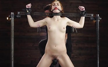 Submissive redhead arse fucked while being restrained