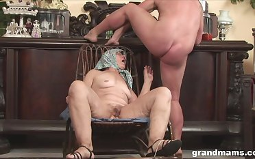 Very old non-professional with glasses spreads her legs alongside be fucked by a gleam
