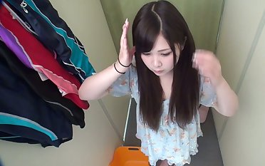 Horny Japanese babe is trying on swimsuit and she's got a ambrosial snatch