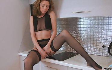 Crude wife Dafna May drops her dress and panties to masturbate
