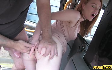 Young redhead plays with the big dick on high the back seat