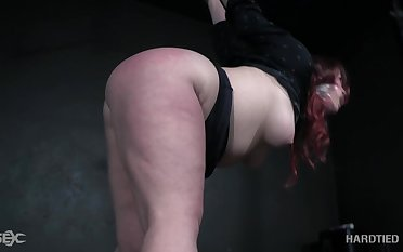 Lustful redheaded bitch with a big bore gets punished away from her thraldom master