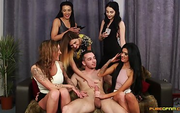 Guy with a massive dick enjoys getting handjobs by lot of horny sluts