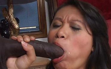 Latina milks a real heavy black cock